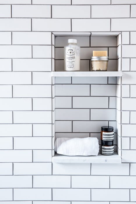 The Classic: Brass Black and White Bathroom Tour - Recessed subway tile shower shelf