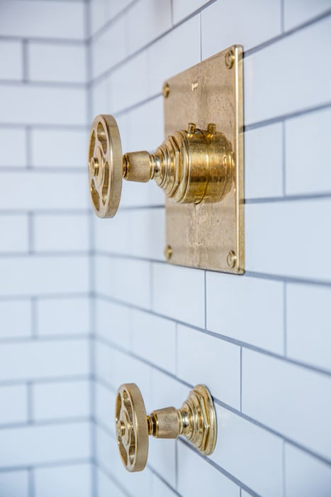 The Classic: Brass Black and White Bathroom Tour - Brass shower fixtures