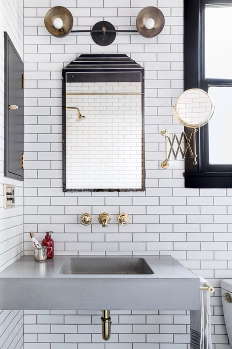 The Classic: Brass Black and White Bathroom Tour - Subway tiles bathroom backsplash with a sleek concrete sink