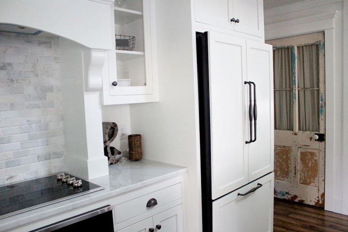 PASSPORT: Before and After Minnesota Farmhouse Cabin Renovation and Makeover Tour - The new fridge design – with doors that blend into the styling of the kitchen