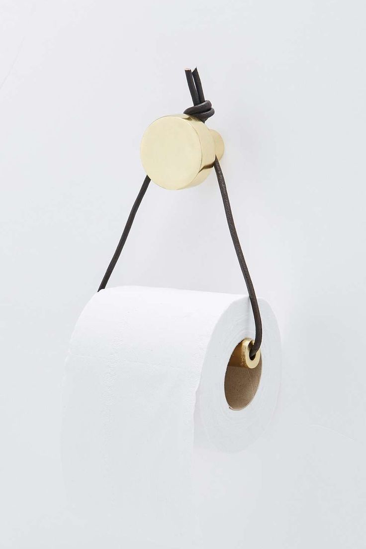 Hanging brass toilet paper holder