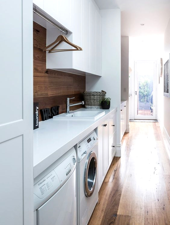 Small Laundry Room With Modern Washer And Wooden Shelves ...